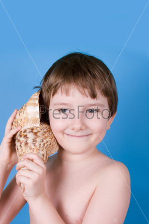 Boy listens to shell