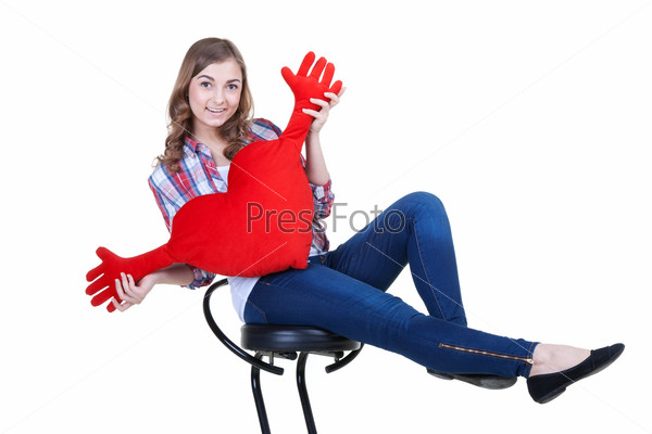 Beautiful girl with A red plush heart