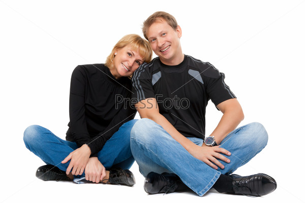 Beautiful couple in love sitting in the lotus position
