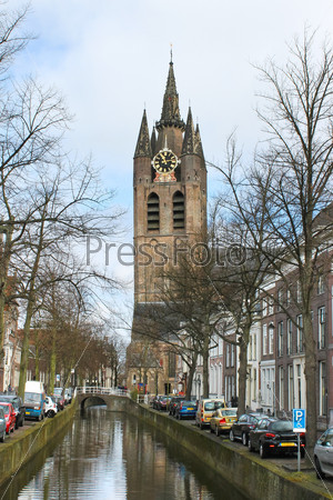 Canal and church tower in Delft, Netherlands