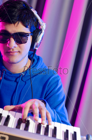Young DJ playing his music