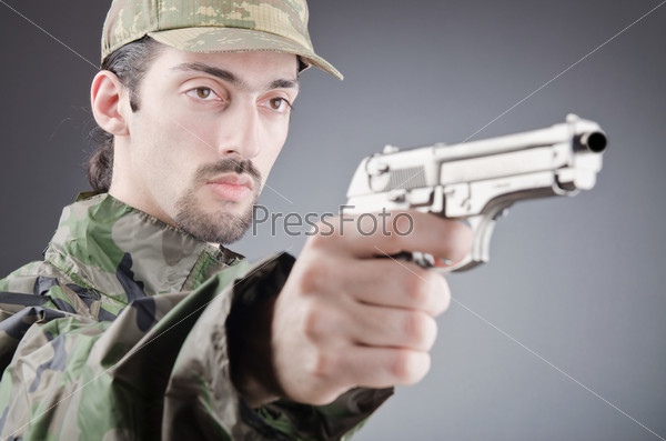 Soldier with gun in studio shooting