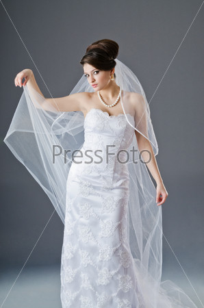 Bride in wedding dress in studio shooting
