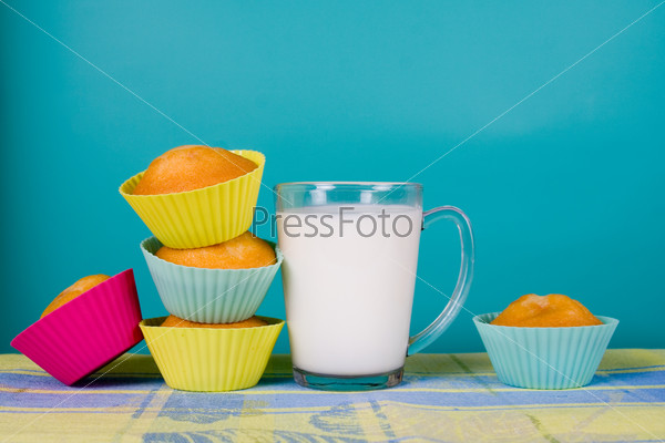 Glass of milk and cupcakes