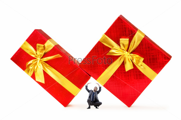Businessman with gift boxes on white