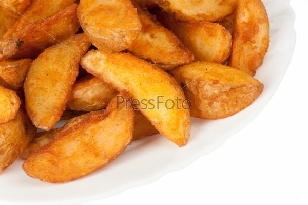 Fried potato wedges isolated on white background