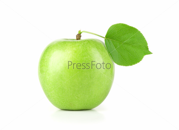 Ripe green apple with a leaf