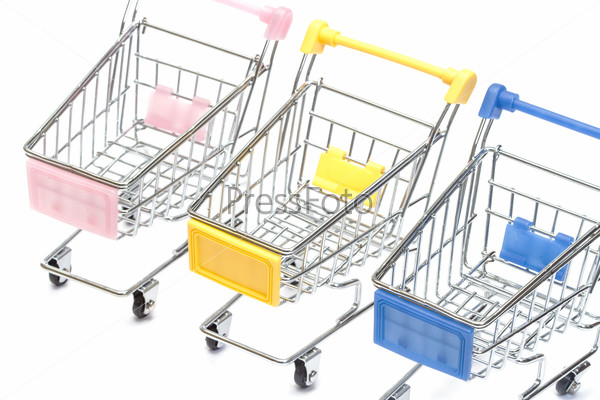 Shopping carts on white, closeup