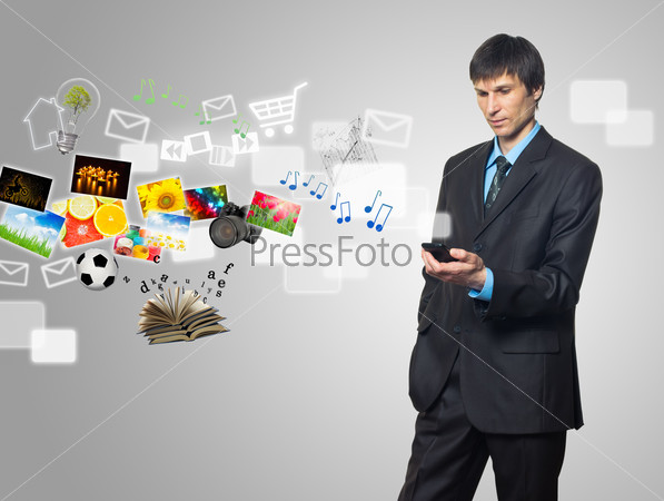 Businessman using touch screen mobile phone with streaming image