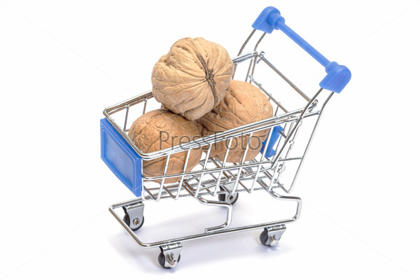 Walnuts in shopping cart on white