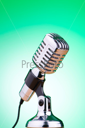 Vintage microphone against the background