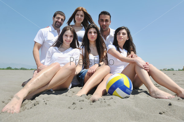 Group of happy young people in have fun at beach