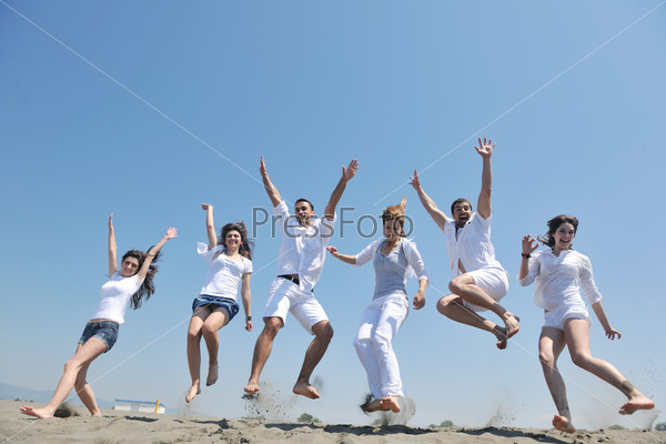 happy people group have fun and running on beach