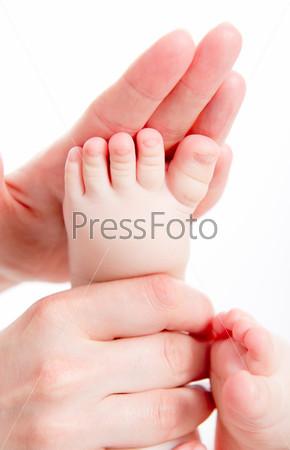 Mother massaging her baby