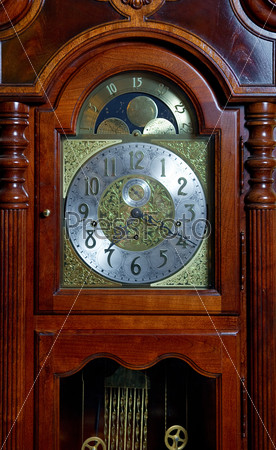 Wooden old-fashioned clock
