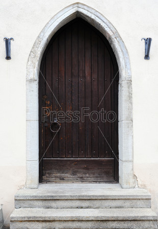 Ancient wooden door design in old city in Tallinn, Estonia