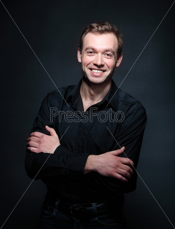 Handsome smiling man in black