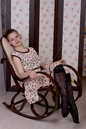 girl in a rocking chair