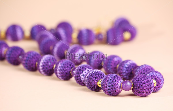 Violet beads at pink background