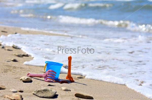 Plastic bucket on the beach