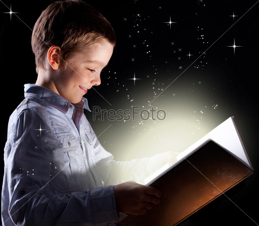 Boy opened a magic book