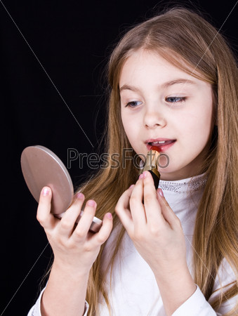 Little girl doing makeup lipstick
