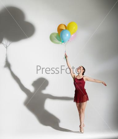 Ballet dancer posing with ballons