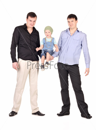 Two guys hold little boy