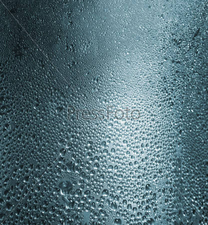 Water drops on a metallic background