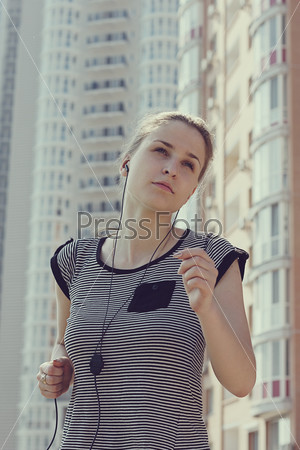 young beautiful woman running in city street