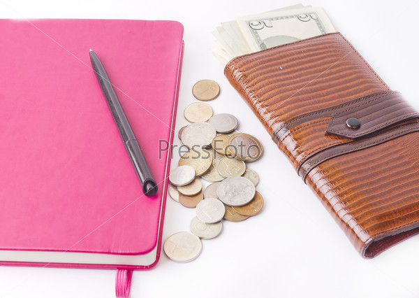 Diary with money and pen isolated