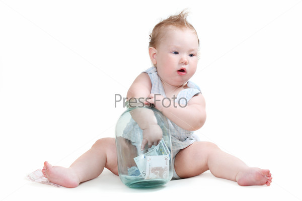 child plays with a glass jar with the money