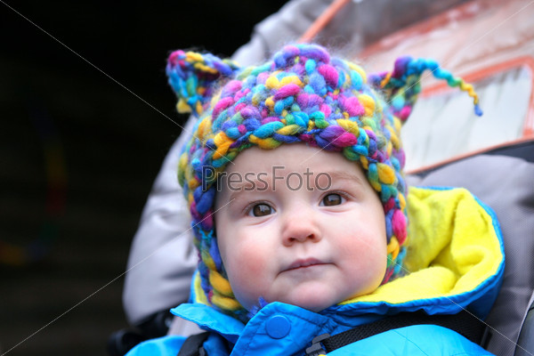 kid in a knitted hat with ears