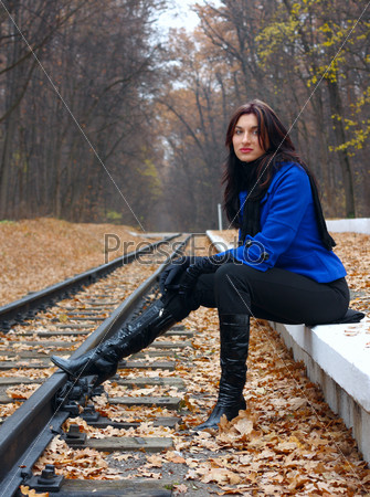 Young woman near the rails