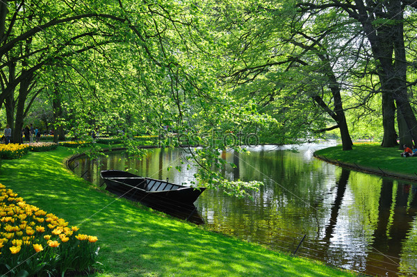 Boat near the river in Keukenhof park in Holland