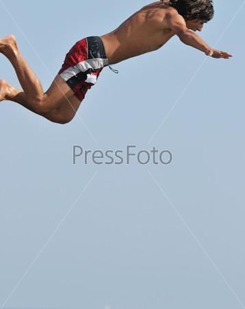 boy jump sea