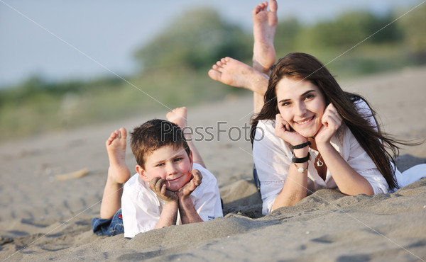 mom and son relaxing on beach