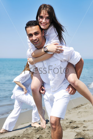 happy young couple have fun on beach