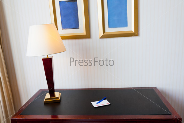 black leather table with electric lamp