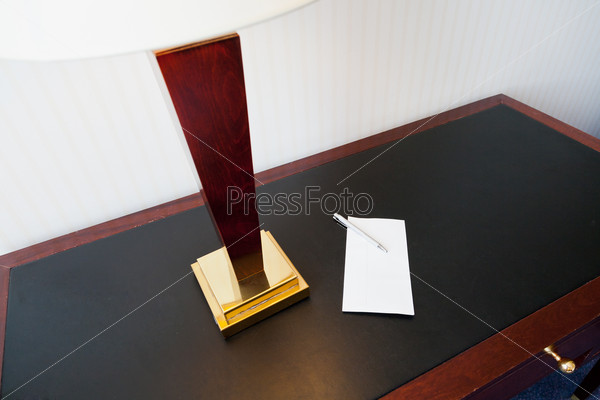 envelope on table with electric lamp