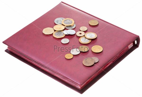different coins on red numismatics album