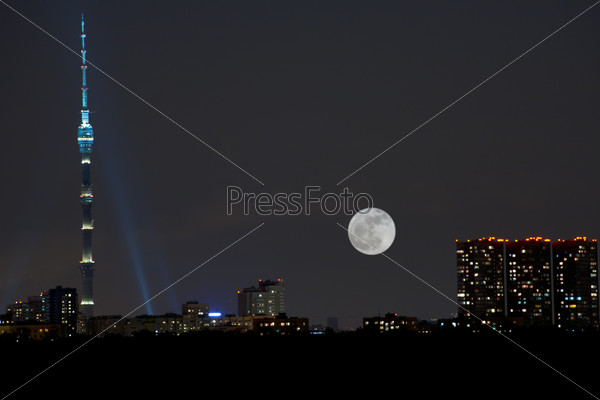 full moon under city