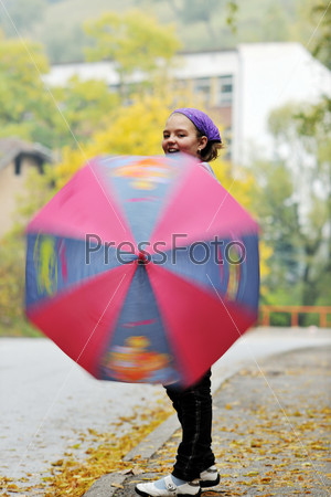 happy girl with umbrella