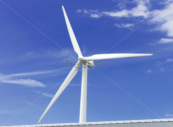 Wind power generator near the cottage roof