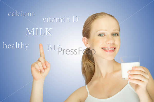 concept of healthy eating. young woman with a glass of milk