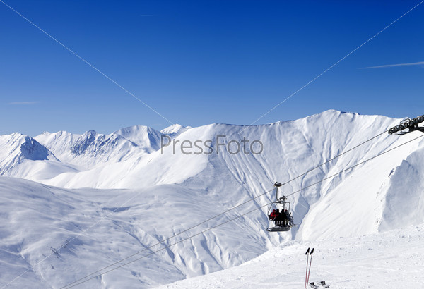 Skiers on ropeway at ski resort Gudauri
