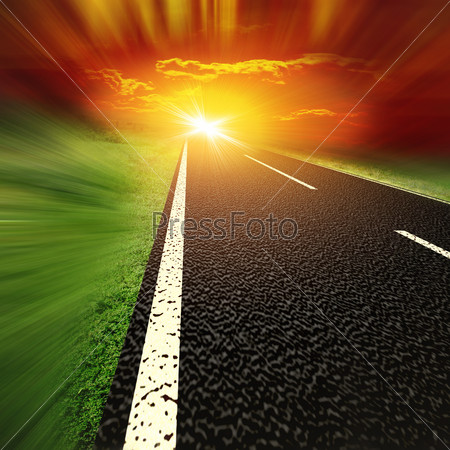 Asphalt road and red bloody blurred sky with sun