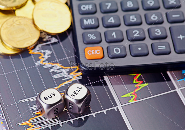 Фотография на тему Финансовая диаграмма, кубики и калькулятор