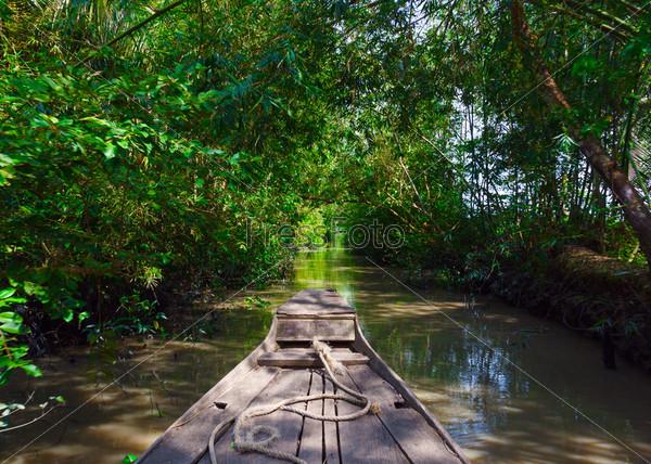 Фотография на тему Лодка в дельте реки Меконг