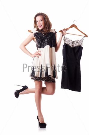 Фотография на тему Молодая женщина примеряет новую одежду на белом фоне